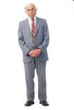 Elderly man standing. Full length portrait of an elder man standing over white Royalty Free Stock Images