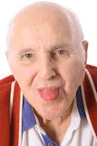 Elderly man sticking out his tongue Royalty Free Stock Image