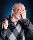 Elderly man suffering from a headache Stock Images