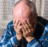 Elderly man suffering from a headache Stock Image