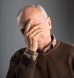 Elderly man suffering from a headache Royalty Free Stock Photos