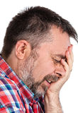 Elderly man suffering from a headache royalty free stock photos