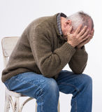 Elderly man suffering from a headache Stock Photo
