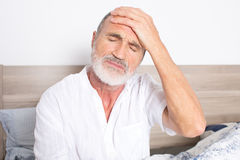 Elderly man suffering from headache Stock Image