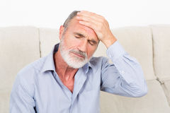 Elderly man suffering from headache Royalty Free Stock Photography