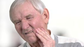 Elderly man suffering from strong tooth pain. Close up senior person suffering from painful teeth. Dental care and health, medical concept stock video footage