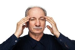 Elderly man suffers from headache royalty free stock photos