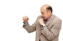 Elderly man in suit boxing Royalty Free Stock Photo