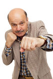 Elderly man in suit boxing Royalty Free Stock Photography