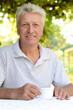 Elderly man in a summer park Royalty Free Stock Photo