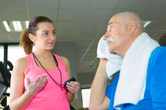 Elderly man sweating after exercise. Elderly men sweating after the exercise stock photo