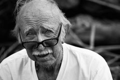 Elderly man in t-shirt and glasses Stock Photography