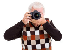 Elderly man taking photos Stock Image