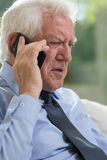 Elderly man talking on mobile phone Royalty Free Stock Images