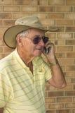 Elderly Man Talking on Mobile Phone. Royalty Free Stock Photography