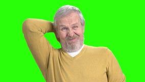 Elderly man with terrible neckache. Stressed senior man with terrible neck pain on chroma key background stock footage