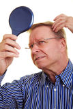 Elderly man with thin hair Stock Images