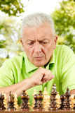 Elderly man thinking Royalty Free Stock Image