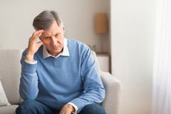 Free Elderly Man Thinking About Loneliness Sitting On Couch At Home Stock Photo - 165582490