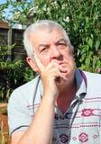 Elderly man thinking close up. Stock Image