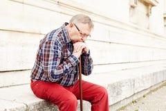 Elderly man thinking outdoor closeup Stock Image