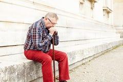 Elderly man thinking outdoor Royalty Free Stock Photo