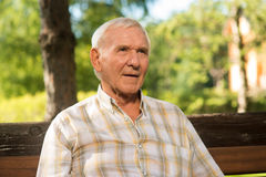 Elderly man with thoughful face. Stock Images