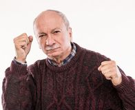 Elderly man threatening with a fists royalty free stock photos