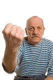 The elderly man threatens with a fist Stock Photo