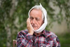 Elderly man with toothache stock photos