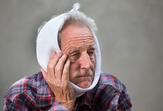 Elderly man with toothache stock photography