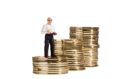 Elderly Man Toy And Coins Royalty Free Stock Image