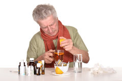Elderly  man treated by medicines Royalty Free Stock Photo