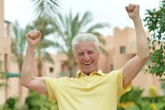 Elderly man at tropic Royalty Free Stock Image