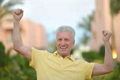 Elderly man at tropic resort Royalty Free Stock Images