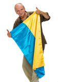 Elderly man with Ukrainian flag in his hands  showing thumbs up Stock Photos