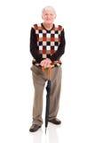 Elderly man umbrella. Handsome elderly man with umbrella isolated on white background Royalty Free Stock Images