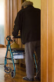 Elderly man use a walker (walking frame) Royalty Free Stock Image