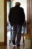 Elderly man use a walker (walking frame) Stock Images