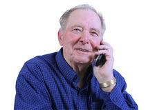 Elderly man using cell phone Royalty Free Stock Images