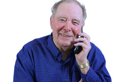 Elderly man using cell phone Royalty Free Stock Image