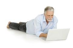 Elderly man using laptop Stock Photos