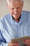 Elderly man using tablet Stock Image