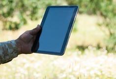 Elderly man using tablet / elderly man reading ebook Stock Image