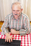 Elderly man using technology Stock Photo