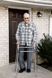Elderly Man With Walker Stock Photo