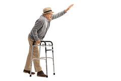 Elderly man with a walker waving Royalty Free Stock Photography