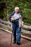 Elderly man Walking Stock Image