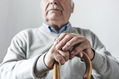 Elderly man with a walking cane royalty free stock photo