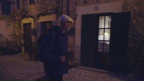 An elderly man walking on the medieval streets of Valdemossa village at night. Mallorca, Balearic Islands, Spain stock video